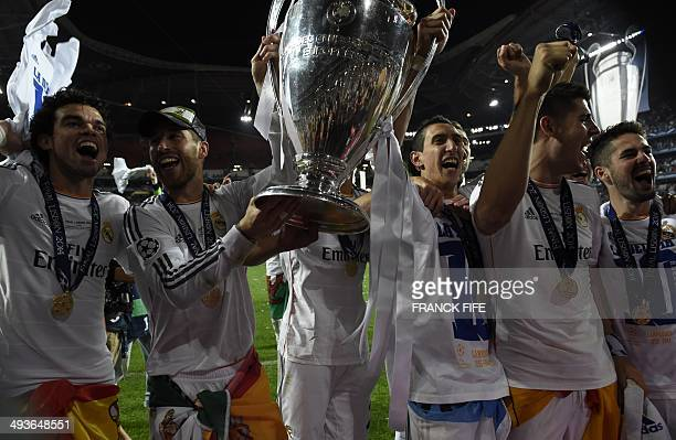 Real Madrid's defender Sergio Ramos and Real Madrid's Portuguese defender Pepe celebrate with the trophy at the end of the UEFA Champions League...