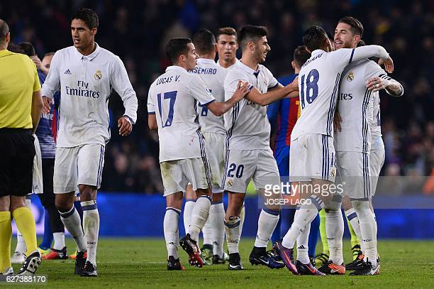 Real Madrid's defender Sergio Ramos and teammates celebrate their 11 draw at the end of the Spanish league football match FC Barcelona vs Real Madrid...