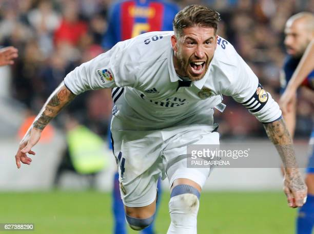 Real Madrid's defender Sergio Ramos celebrates after scoring a goal during the Spanish league football match FC Barcelona vs Real Madrid CF at the...
