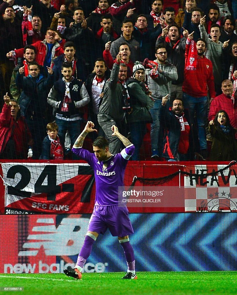 Real Madrid's defender Sergio Ramos celebrates after scoring a goal during the Spanish Copa del Rey (King's Cup) round of 16 second leg football match Sevilla FC vs Real Madrid CF at the Ramon Sanchez Pizjuan stadium in Sevilla on January 12, 2017. / AFP / CRISTINA