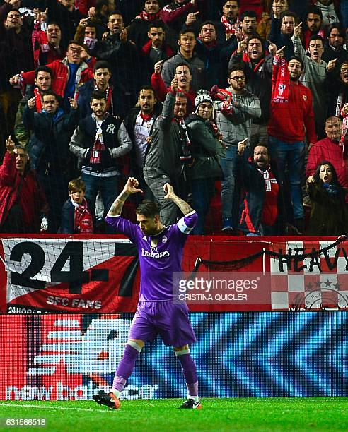 Real Madrid's defender Sergio Ramos celebrates after scoring a goal during the Spanish Copa del Rey round of 16 second leg football match Sevilla FC...