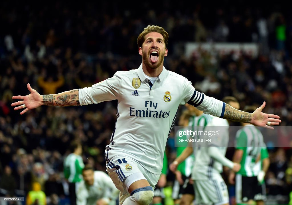 TOPSHOT - Real Madrid's defender Sergio Ramos celebrates after scoring a goal during the Spanish league footbal match Real Madrid CF vs Real Betis at the Santiago Bernabeu stadium in Madrid on March 12, 2017. /
