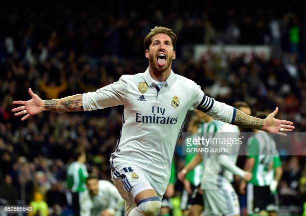 TOPSHOT Real Madrid's defender Sergio Ramos celebrates after scoring a goal during the Spanish league footbal match Real Madrid CF vs Real Betis at...