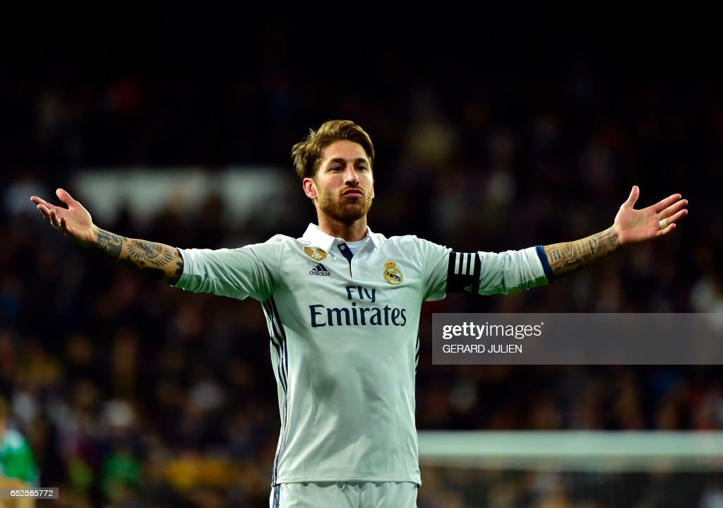 Real Madrid's defender Sergio Ramos celebrates after scoring a goal during the Spanish league footbal match Real Madrid CF vs Real Betis at the Santiago Bernabeu stadium in Madrid on March 12, 2017. /