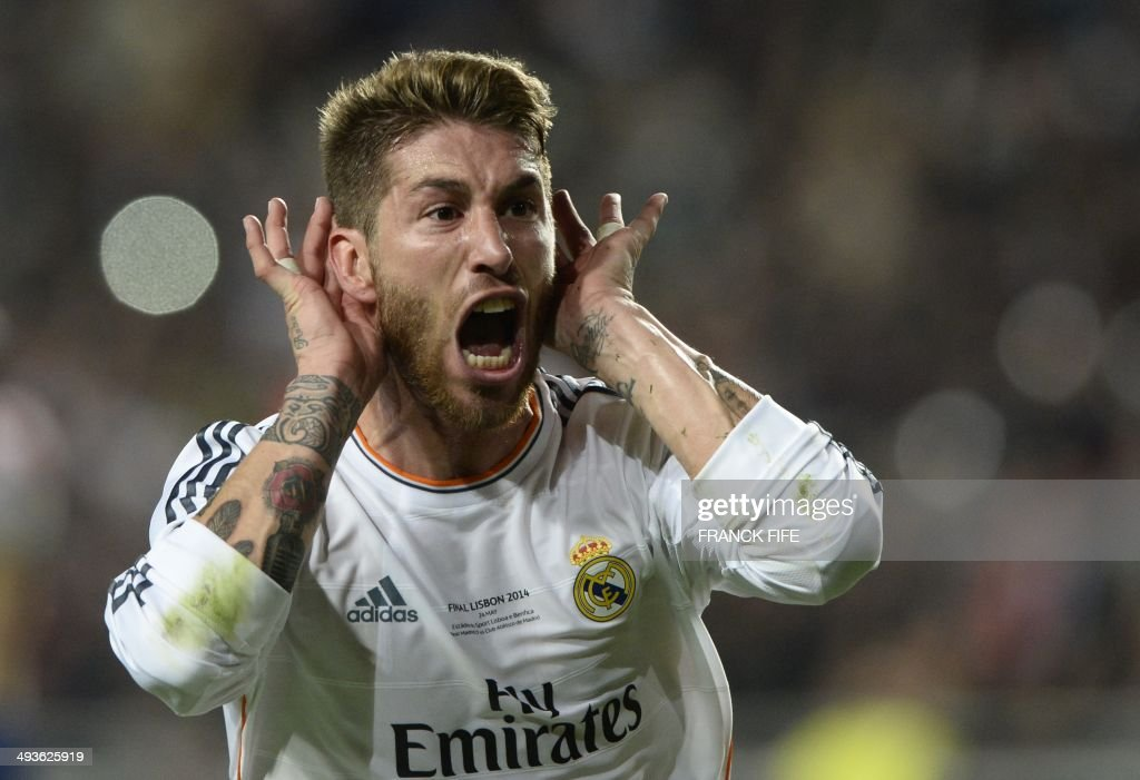 Real Madrid's defender Sergio Ramos celebrates after scoring during the UEFA Champions League Final Real Madrid vs Atletico de Madrid at Luz stadium in Lisbon, on May 24, 2014. AFP PHOTO/ FRANCK FIFE / AFP PHOTO / Franck FIFE