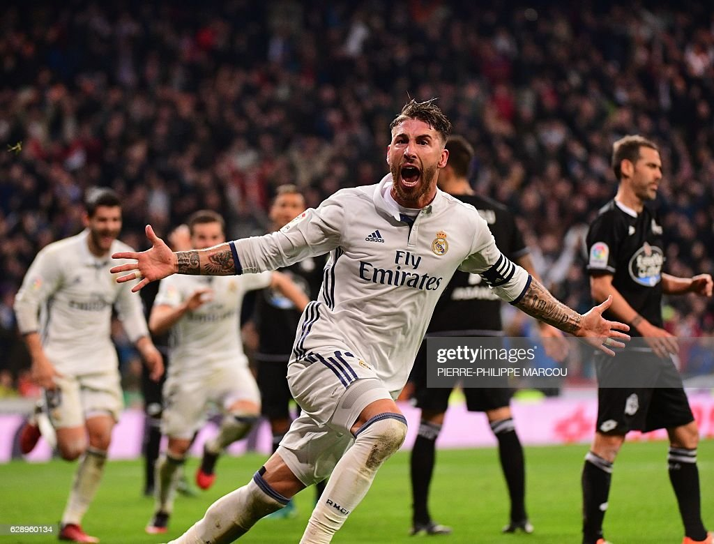 Real Madrid's defender Sergio Ramos celebrates after scoring during the Spanish league football match Real Madrid CF vs RC Deportivo at the Santiago Bernabeu stadium in Madrid on December 10, 2016. / AFP / PIERRE