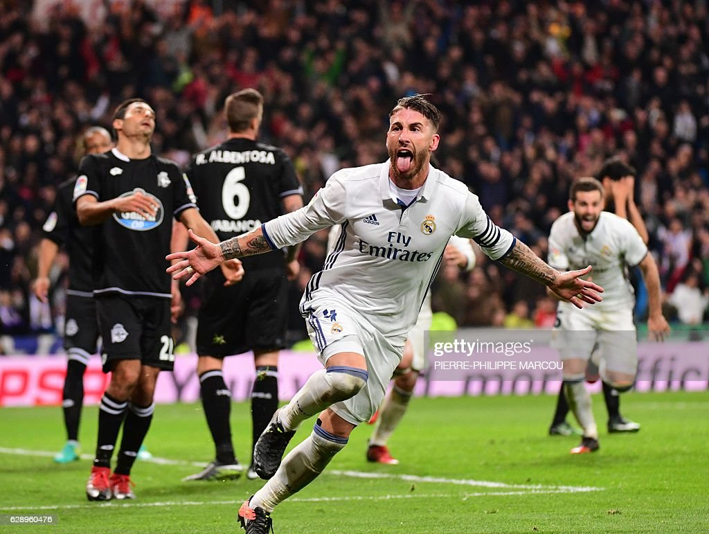 TOPSHOT - Real Madrid's defender Sergio Ramos celebrates after scoring during the Spanish league football match Real Madrid CF vs RC Deportivo at the Santiago Bernabeu stadium in Madrid on December 10, 2016. / AFP / PIERRE