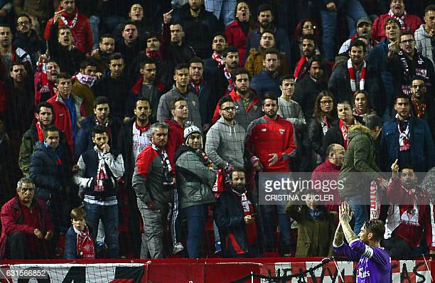 Real Madrid's defender Sergio Ramos celebrates after scoring during the Spanish Copa del Rey round of 16 second leg football match Sevilla FC vs Real...