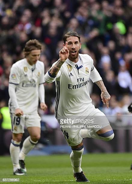 Real Madrid's defender Sergio Ramos celebrates after scoring during the Spanish league football match Real Madrid CF vs Malaga CF at the Santiago...