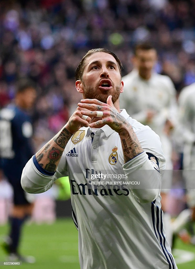 Real Madrid's defender Sergio Ramos celebrates after scoring during the Spanish league football match Real Madrid CF vs Malaga CF at the Santiago Bernabeu stadium in Madrid on January 21, 2017. / AFP / PIERRE