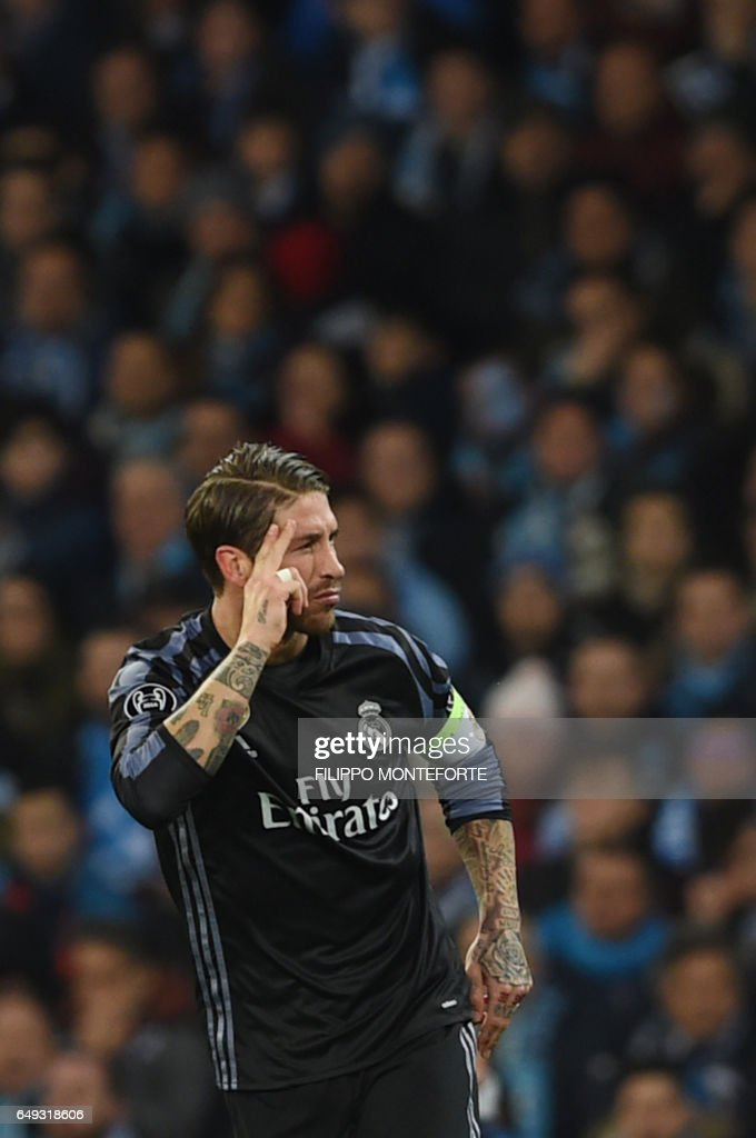 Real Madrid's defender Sergio Ramos celebrates after scoring during the UEFA Champions League football match SSC Napoli vs Real Madrid on March 7, 2017 at the San Paolo stadium in Naples. / AFP PHOTO / Filippo MONTEFORTE
