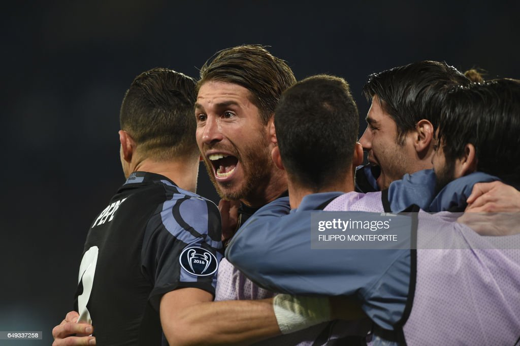 TOPSHOT - Real Madrid's defender Sergio Ramos celebrates after scoring during the UEFA Champions League football match SSC Napoli vs Real Madrid on March 7, 2017 at the San Paolo stadium in Naples. Real Madrid won 1-3. / AFP PHOTO / Filippo MONTEFORTE