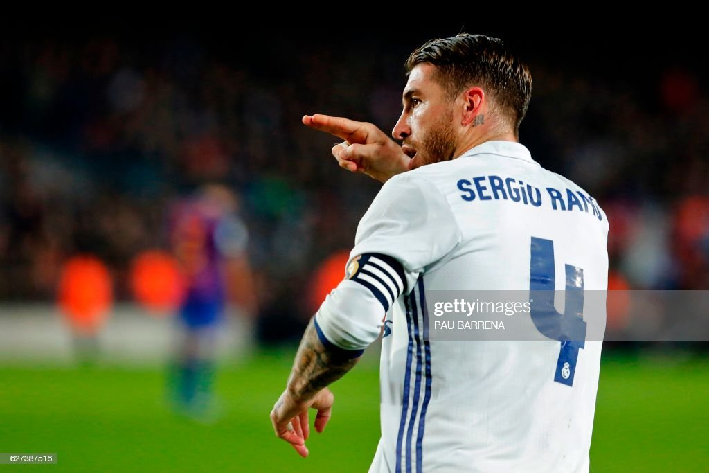 Real Madrid's defender Sergio Ramos celebrates after scoring the equalizer during the Spanish league football match FC Barcelona vs Real Madrid CF at the Camp Nou stadium in Barcelona on December 3, 2016. /