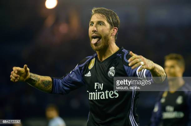 TOPSHOT Real Madrid's defender Sergio Ramos celebrates their third goal sticking out his tongue at Celta's supporters during the Spanish league...