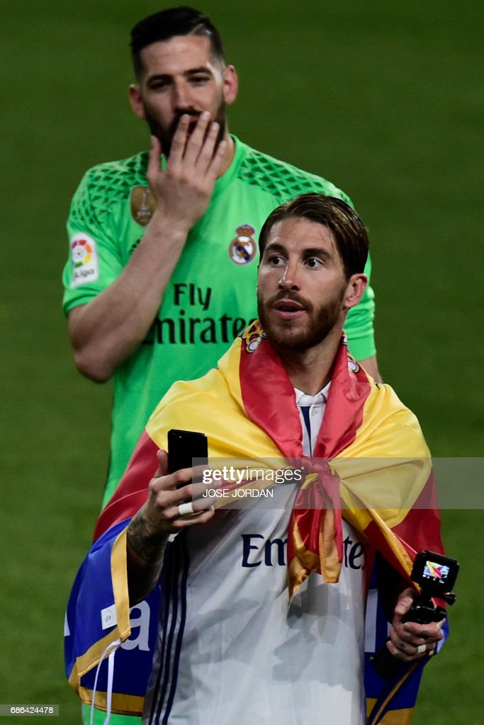 Real Madrid's defender Sergio Ramos celebrates winning the Liga title after the Spanish league football match Malaga CF vs Real Madrid CF at La Rosaleda stadium in Malaga on May 21, 2017. /