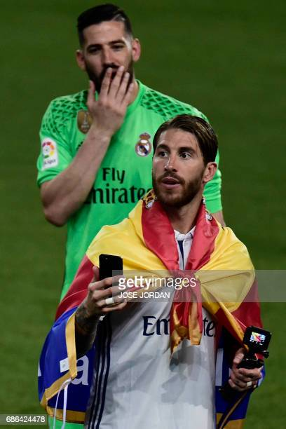 Real Madrid's defender Sergio Ramos celebrates winning the Liga title after the Spanish league football match Malaga CF vs Real Madrid CF at La...