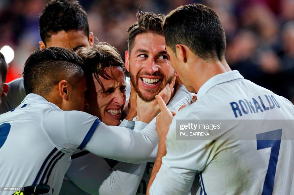 Real Madrid's defender Sergio Ramos (2ndR) celebrates with Real Madrid's Croatian midfielder Luka Modric (2ndL) and teammates after scoring the equalizer during the Spanish league football match FC Barcelona vs Real Madrid CF at the Camp Nou stadium in Barcelona on December 3, 2016. /