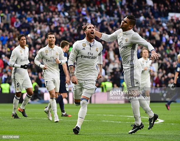 Real Madrid's defender Sergio Ramos celebrates with Real Madrid's Brazilian midfielder Casemiro after scoring during the Spanish league football...