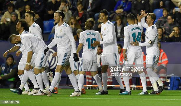 Real Madrid's defender Sergio Ramos celebrates with teammates after scoring during the Spanish league football match between Levante UD and Real...