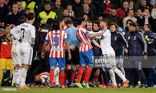 Real Madrid's defender Sergio Ramos clashes with Atletico Madrid's Argentinian midfielder Raul Garcia during the Spanish King's Cup final football...