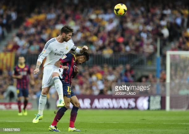 Real Madrid's defender Sergio Ramos clashes with Barcelona's Brazilian forward Neymar da Silva Santos Junior during the Spanish league Clasico...