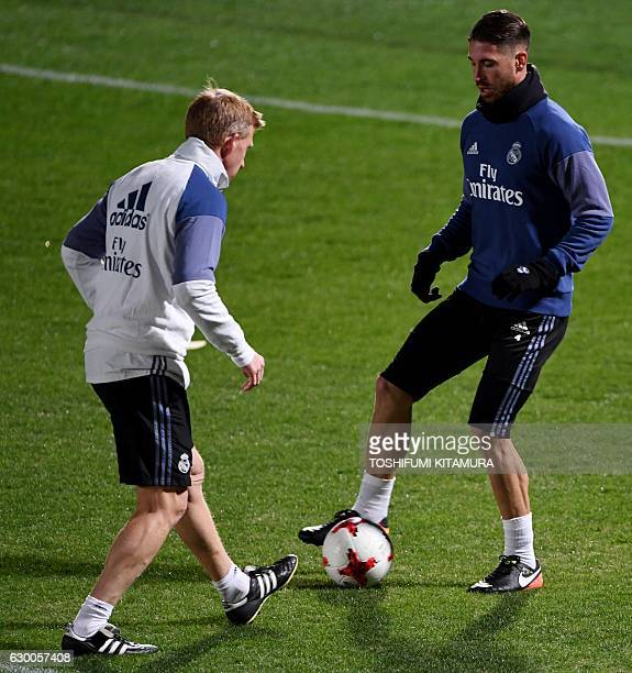 Real Madrid's defender Sergio Ramos dribbles the ball during a training session at Mitsuzawa stadium in Yokohama on December 16 ahead of their Club...