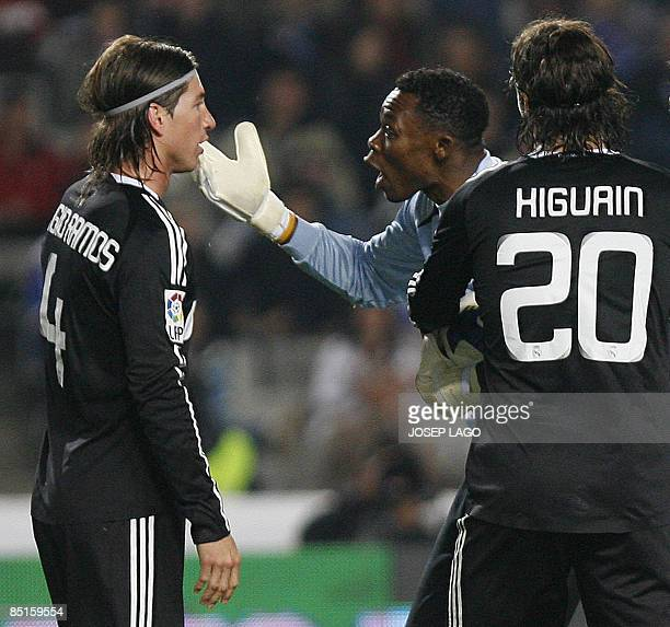 Real Madrid's Defender Sergio Ramos Garcia argues with Espanyol goalkeeper Carlos Kameni during their League football match at the Olympic Stadium in...