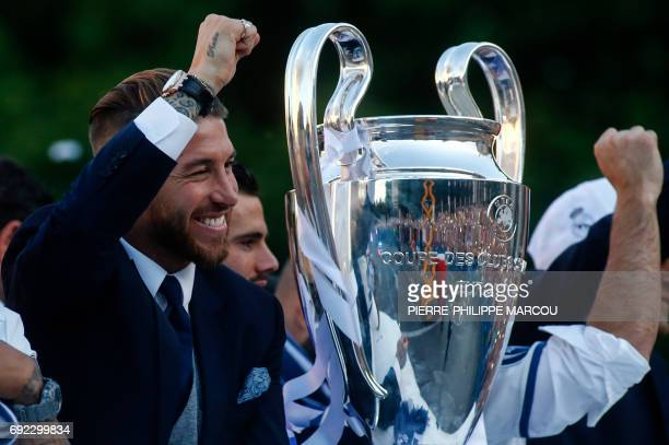 Real Madrid's defender Sergio Ramos gestures next to the trophy celebrating the team's win ontop of a bus on Plaza Cibeles in Madrid on June 4 2017...