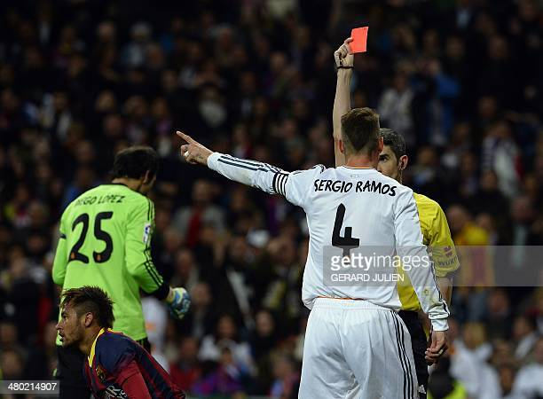 Real Madrid's defender Sergio Ramos is shown a red card during the Spanish league Clasico football match Real Madrid CF vs FC Barcelona at the...