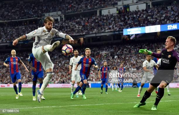 Real Madrid's defender Sergio Ramos kicks the ball past Barcelona's German goalkeeper MarcAndre Ter Stegen during the Spanish league Clasico football...