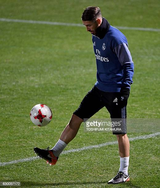 Real Madrid's defender Sergio Ramos plays with the ball during a training session at Mitsuzawa stadium in Yokohama on December 16 ahead of their Club...
