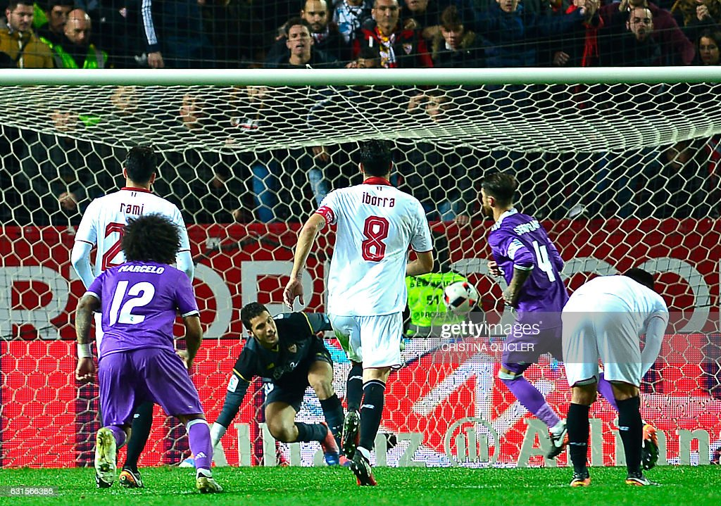 Real Madrid's defender Sergio Ramos (2ndR) reacts after scoring a goal during the Spanish Copa del Rey (King's Cup) round of 16 second leg football match Sevilla FC vs Real Madrid CF at the Ramon Sanchez Pizjuan stadium in Sevilla on January 12, 2017. / AFP / CRISTINA