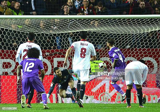 Real Madrid's defender Sergio Ramos reacts after scoring a goal during the Spanish Copa del Rey round of 16 second leg football match Sevilla FC vs...