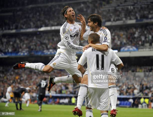 Real Madrid's defender Sergio Ramos Real Madrid's Brazilian midfielder Kaka and Real Madrid's French forward Karim Benzema celebrate after scoring...