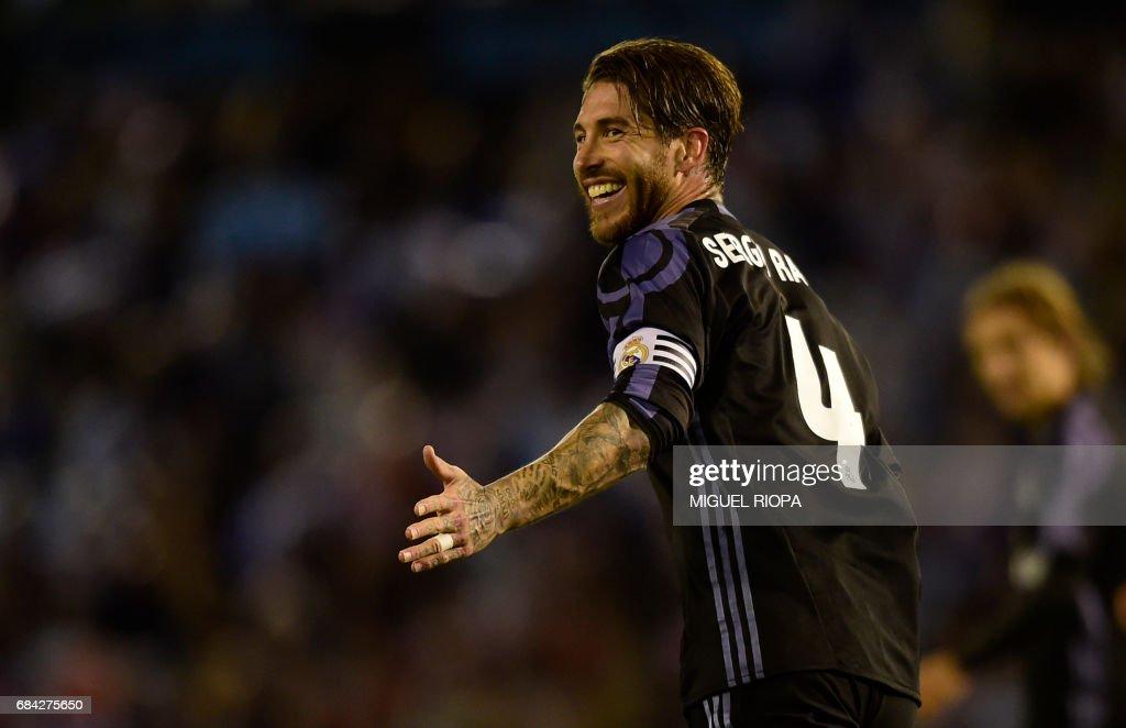 Real Madrid's defender Sergio Ramos smiles during the Spanish league football match RC Celta de Vigo vs Real Madrid CF at the Balaidos stadium in Vigo on May 17, 2017. Real Madrid won 4-1. /
