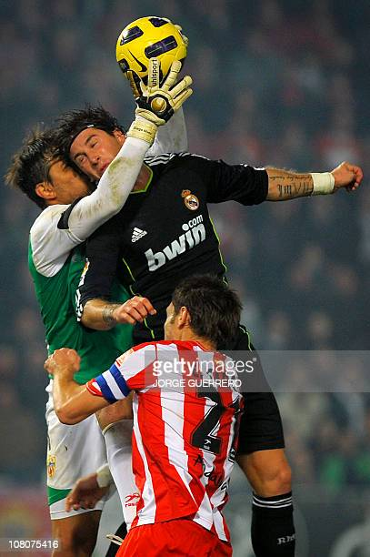 Real Madrid's defender Sergio Ramos vies with Almeria's Brazilian goalkeeper Diego Alves and defender Carlos Garcia during the Spanish league...