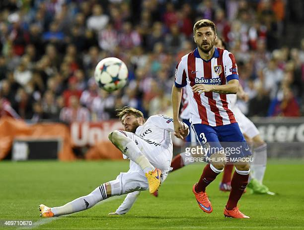 Real Madrid's defender Sergio Ramos vies with Atletico Madrid's Brazilian defender Guilherme Siqueira during the UEFA Champions League quarter final...