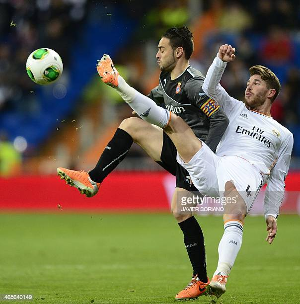 Real Madrid's defender Sergio Ramos vies with Espanyol's forward Sergio Garcia during the Copa del Rey quarterfinal second leg football match Real...