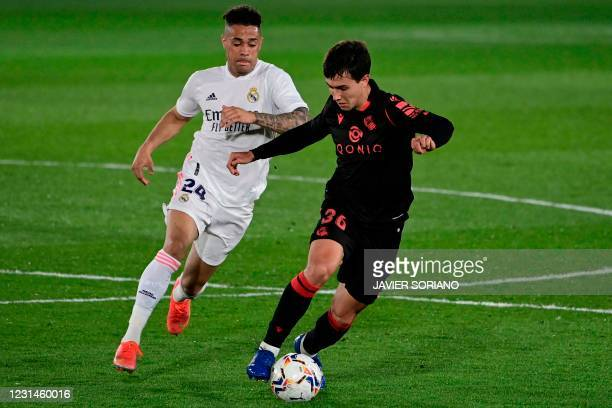 Real Madrid's Dominican forward Mariano Diaz challenges Real Sociedad's Spanish midfielder Martin Zubimendi during the Spanish league football match...
