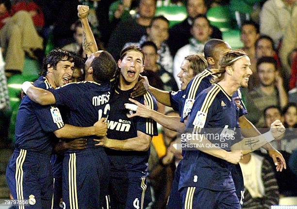 Real Madrid's Drenthe celebrates with teammates after scoring against Betis during a Spanish league football match at the Ruiz de Lopera stadium in...