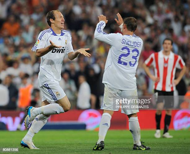 Real Madrid's Dutch Arjen Robben is congratuled by his teammate Dutch Wesley Sneijder after scoring during their Spanish League football match at the...