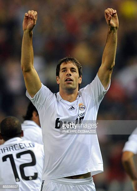 Real Madrid's Dutch striker Ruud Van Nistelrooy celebrates after scoring against Atletico Madrid during a Spanish league football match at the...