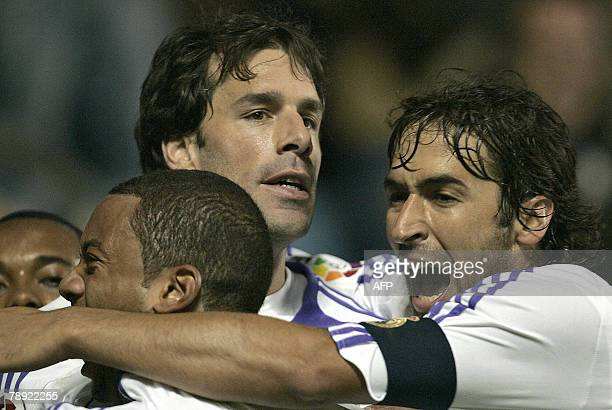 Real Madrid's Dutch Van Nistelrooy celebrates his goal with teanmate during their Spanish league football match against Levante 13 January 2008 at...
