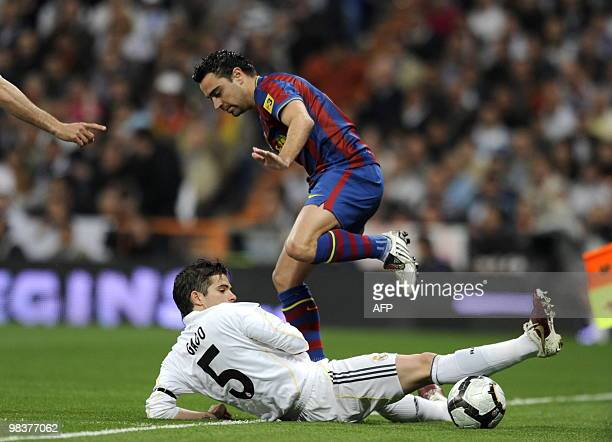 Real Madrid's Fernando Gago vies for the ball with Barcelona's midfielder Xavi Hernandez during the 'El Clasico' Spanish League football match Real...