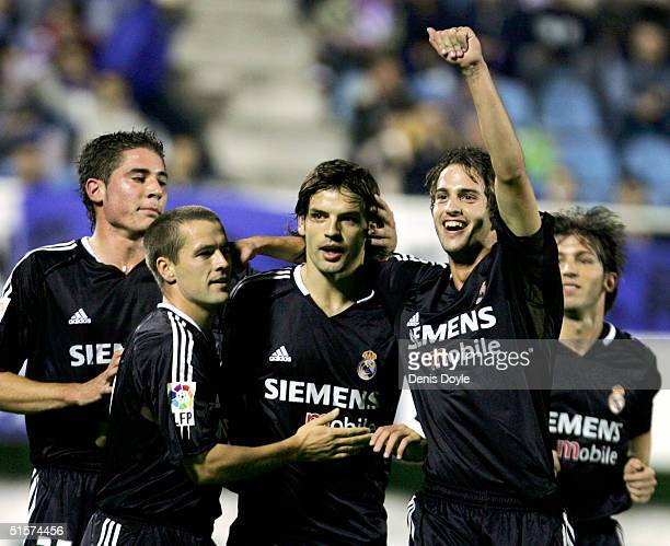 Real Madrids Fernando Morientes is congratulated by Javi Garcia Englands Michael Owen and Alex Perez after he scored a goal against Second B division...