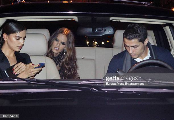Real Madrid's football player Cristiano Ronaldo his girlfriend model Irina Shayk and model Izabel Goulart are seen on November 27 2012 in Madrid Spain