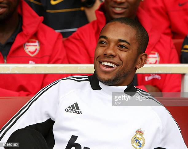 Real Madrid's footballer Robinho on the bench against SV Hamburg during the Emirates Cup competition at the Emirates stadium in north London on...