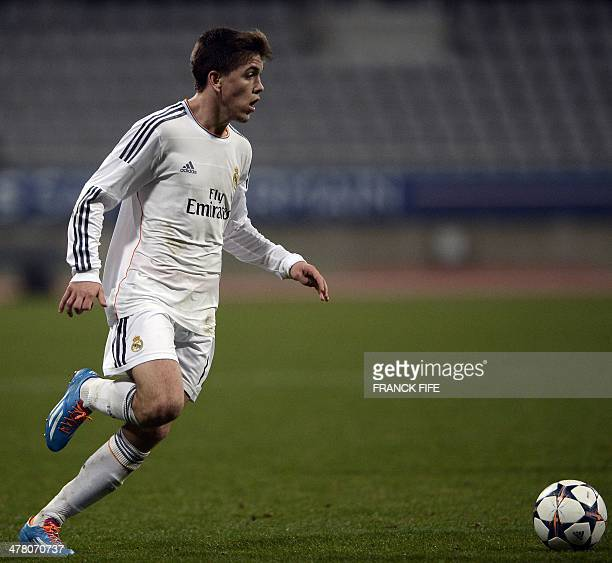 Real Madrid's forward Agoney Gonzales controls the ball during the UEFA Youth League quarterfinal football match between PSG and Real Madrid at the...