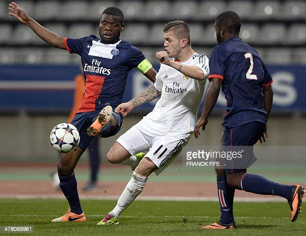 Real Madrid's forward Agoney Gonzalez vies with ParisSaintGermain's captain Franck Bambock and defender Stephane Lambese during the UEFA Youth League...