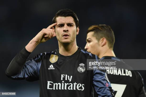 Real Madrid's forward Alvaro Morata celebrates after scoring at the end of the UEFA Champions League football match SSC Napoli vs Real Madrid on...